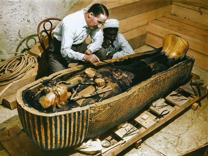 Howard Carter examining the tomb of Tutankhamun in 1922