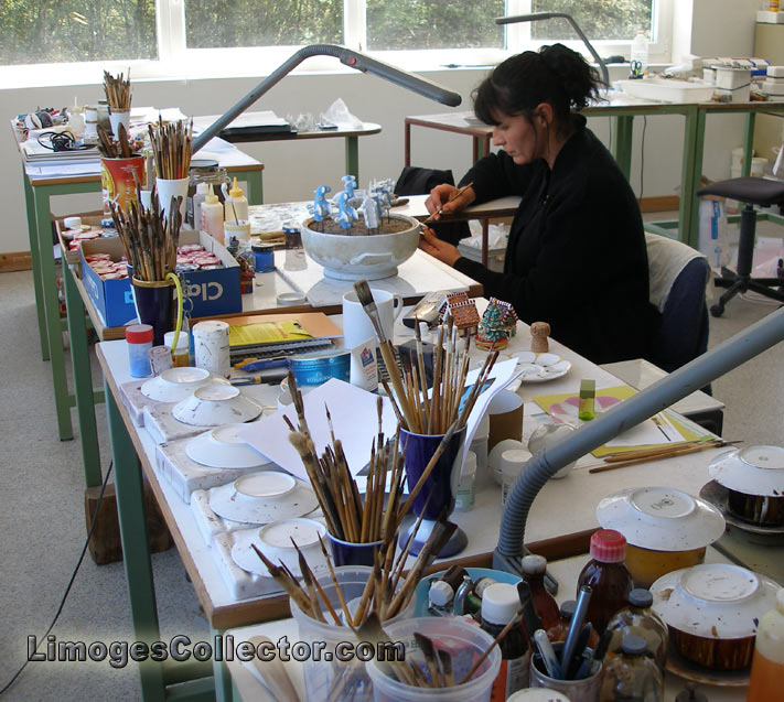 An artist hand-painting Limoges boxes | LimogesCollector.com