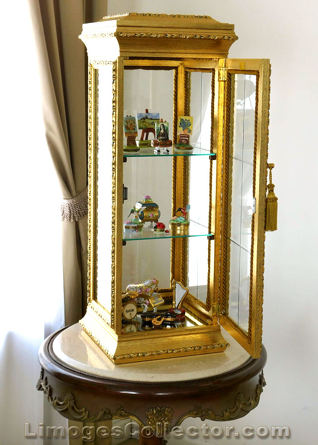 Decorate your home with Italian Gold Curio Cabinets | Limogescollector.com